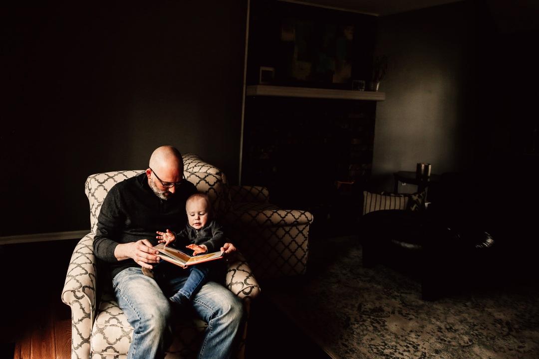Kansas City Family Documentary Lifestyle Photography Baby Reading Daddy