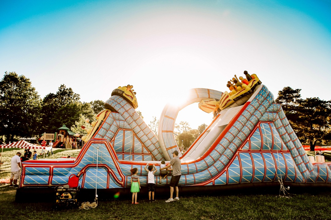 Inflatable ride carnival kids family sunset