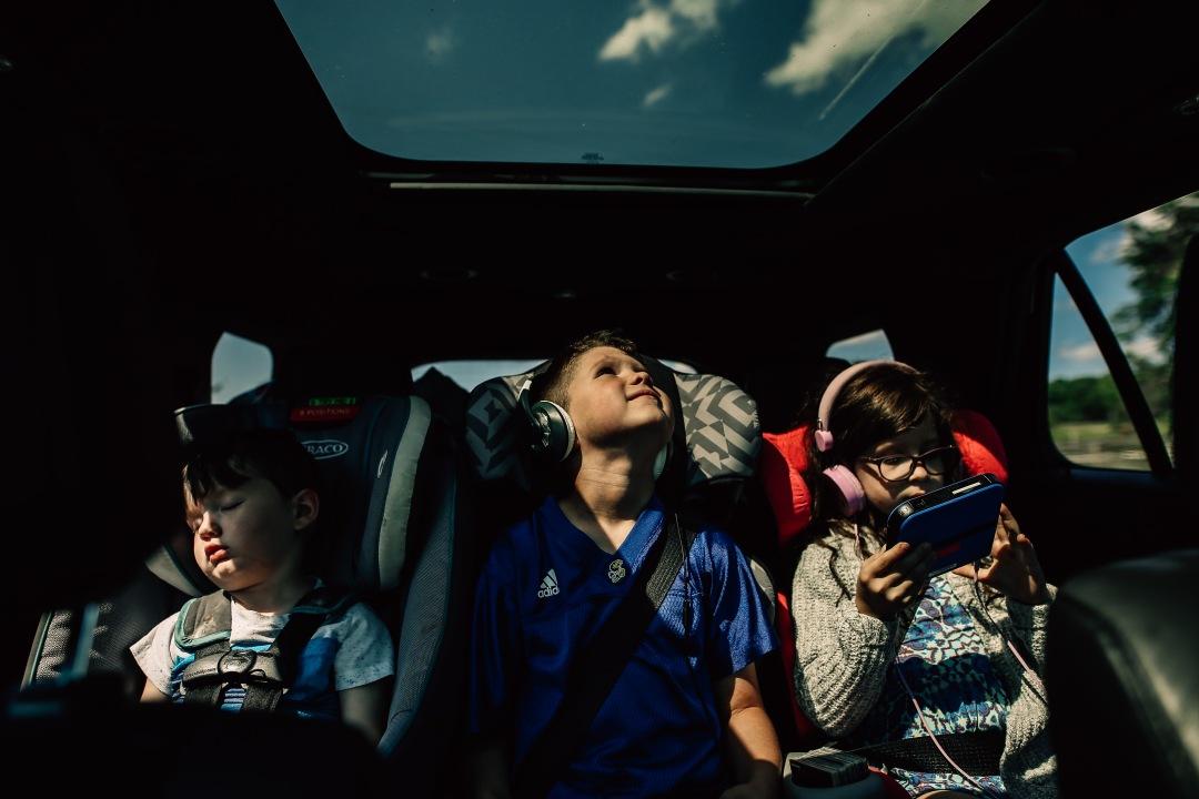 Children Car ride documentary photography headphones sleeping
