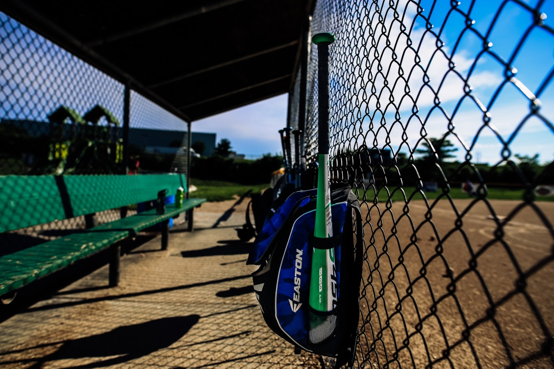 baseball field summer dugout bat bag dirt