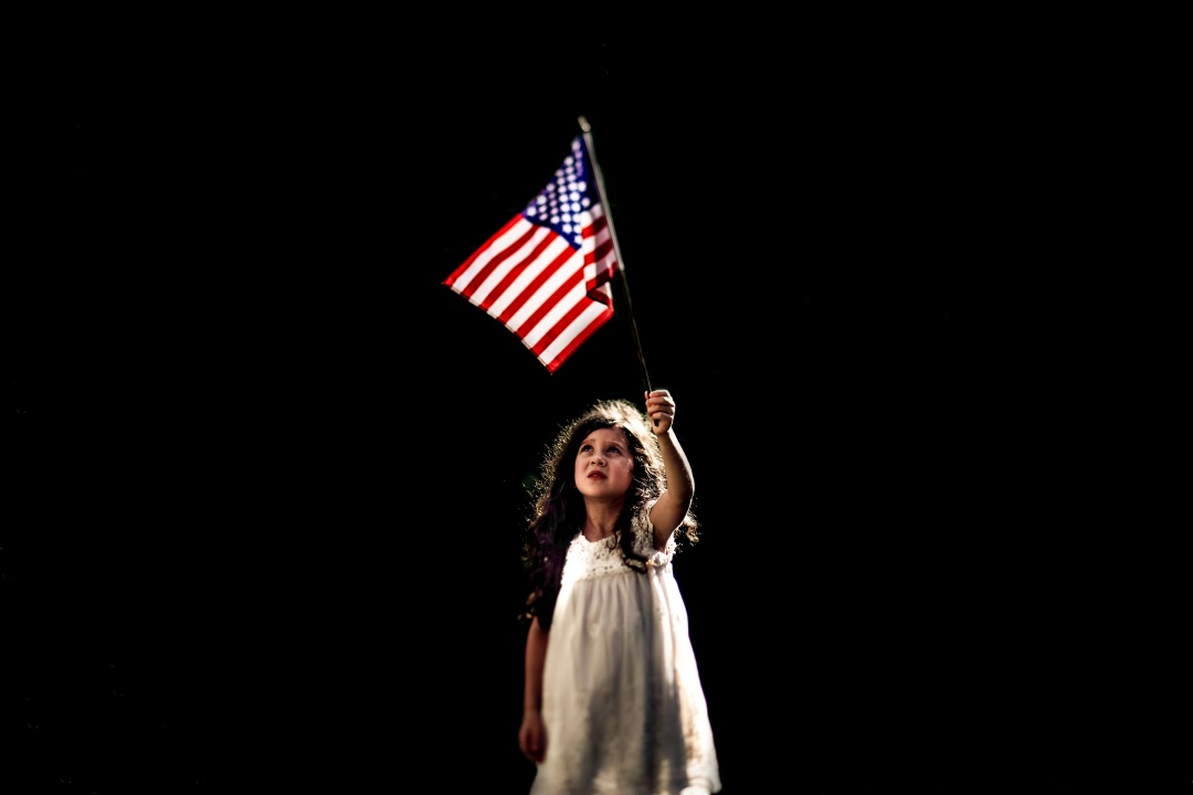 Girl American Flag dramatic light patriotic photography