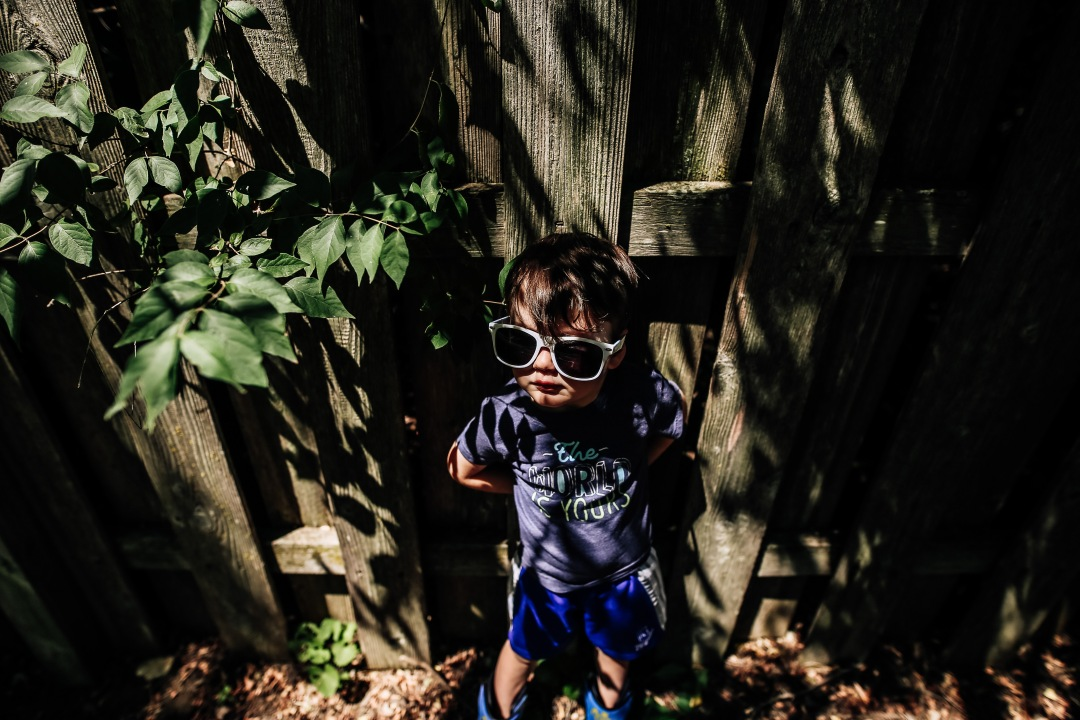 boy sunglasses shade tree