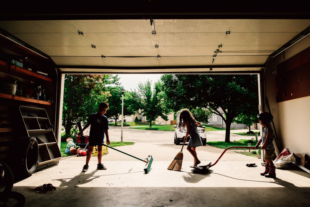 Kids Cleaning garage sweeping documentary photography
