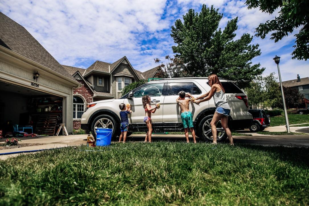 washing car driveway self portrait motherhood children summertime joy