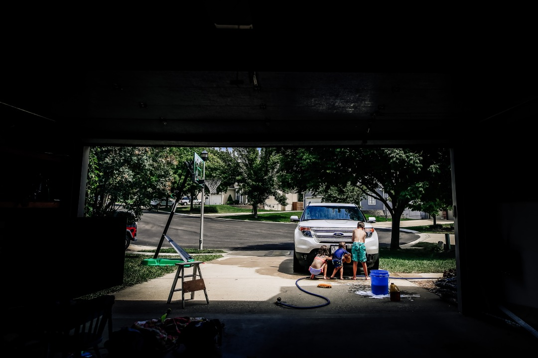 children washing car driveway summer kansas city ford explorer water soap hose