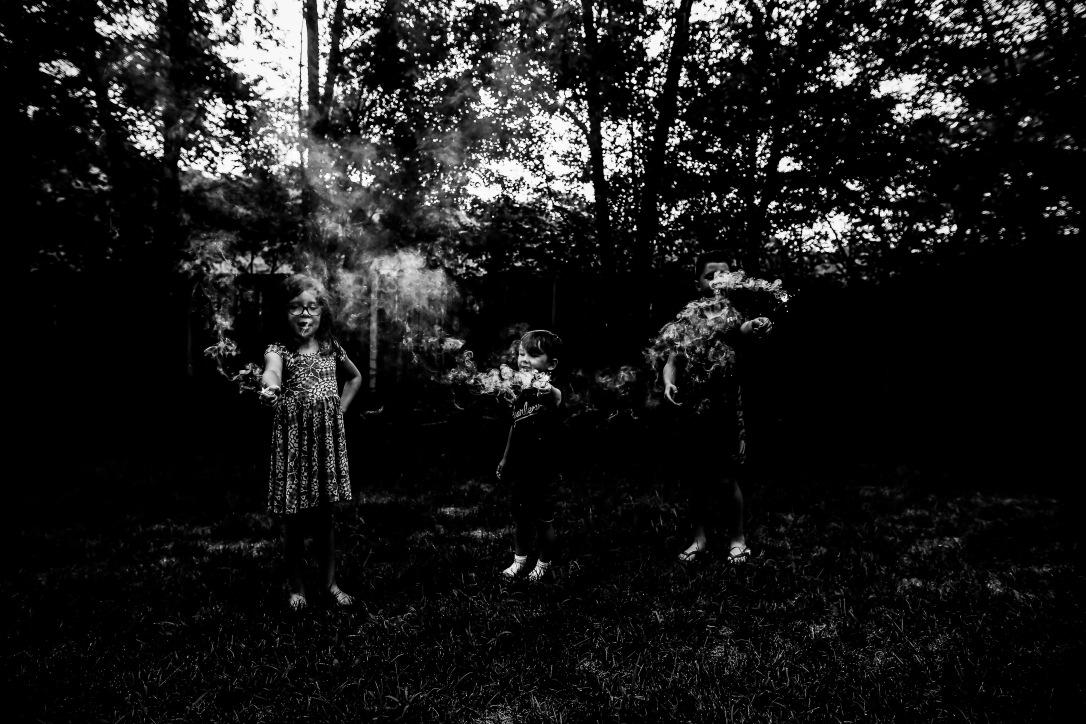 children sparklers summer kansas city black and white