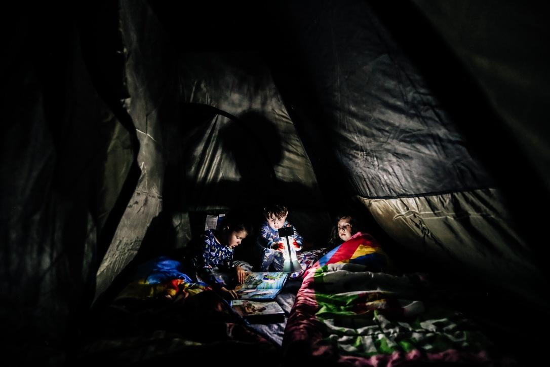 children backyard tent camping low light lantern night time summer kansas city
