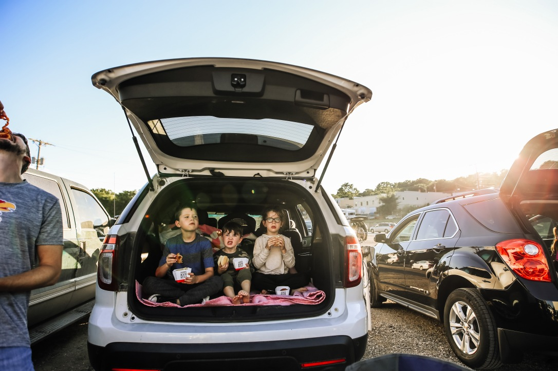 drive in movie kids car trunk dinner summer