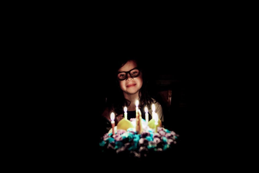 birthday cake candles girl low light