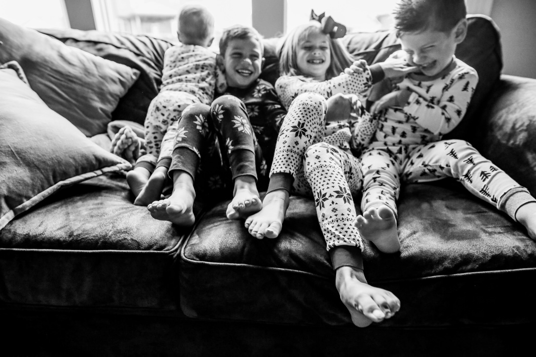family photography kids laughing matching jammies christmas