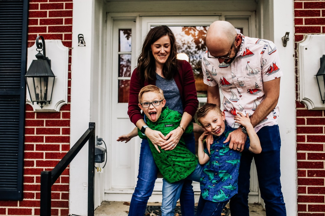 family photography at home session porch laughing