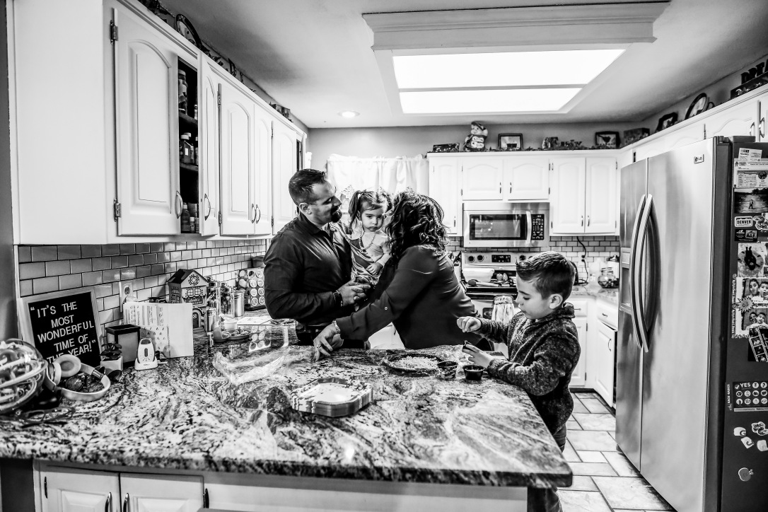 family photography at home session kitchen cooking pizza