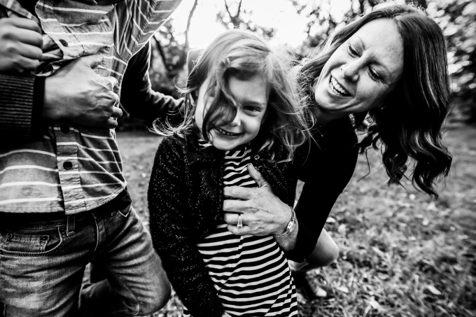 family photography laughter tickle snuggle mom daughter