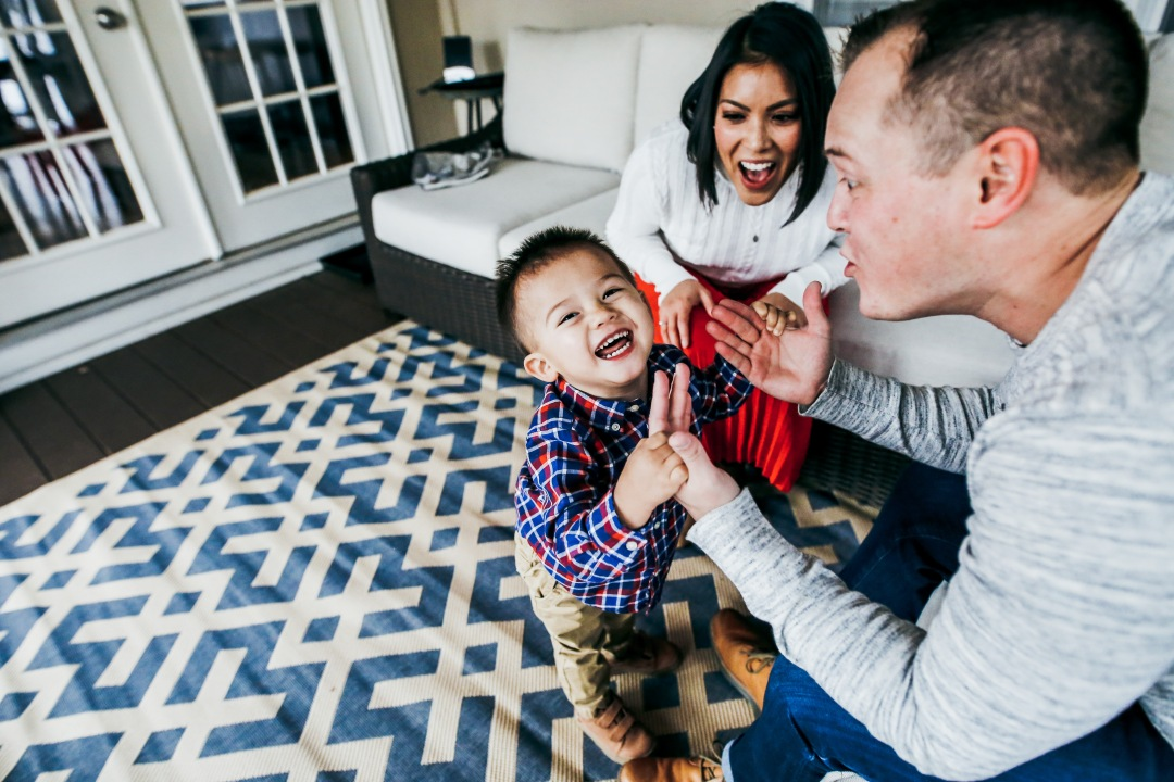 family photography laughing at home session toddler boy