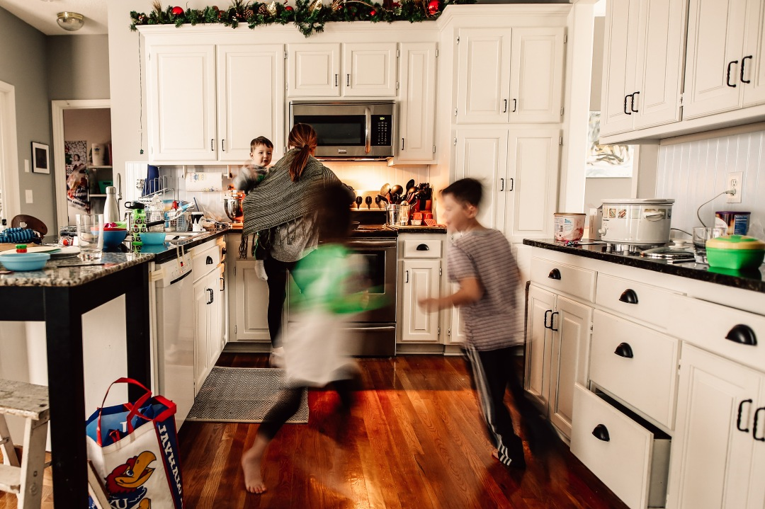 self portrait motherhood messy kitchen running kids documentary photography