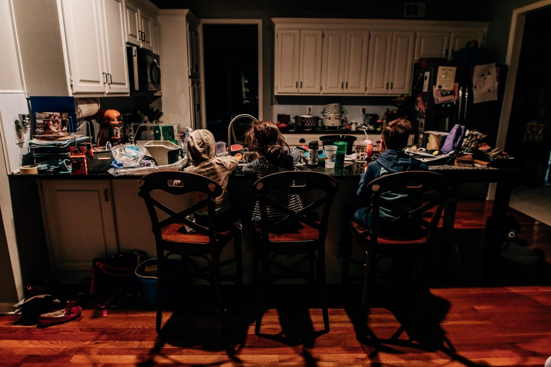 Three kids kitchen messy indoor light documentary photography