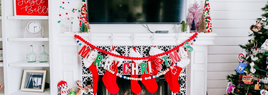 Christmas mantel holiday decor pom pom trees multi colored stockings
